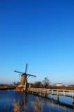 Windmühle mit Brücke Stockfotos