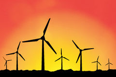 Windmühlenschattenbilder bei Sonnenuntergang Stockfotos