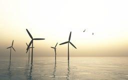 Windmühlen über weichem Meer Stockfotografie