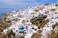 Windmile and houses of Oia Royalty Free Stock Photos