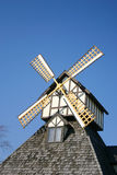 Windmill 1. A decorative windmill on top of this building Stock Image