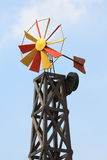 Windmill. Colorful windmill on blue sky Stock Photos