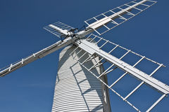 Windmill. A white wooden windmill in Thorpeness, Suffolk Royalty Free Stock Photo