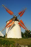 Windmill. Old white breton windmill with red sails against blue sky in morbihan in france Royalty Free Stock Photos