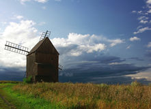 Windmill. Wooden windmill on field.Silesia,Czech republik Stock Photos