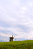 Windmill. On a beautiful green meadow Royalty Free Stock Photos
