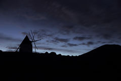 Windmill. Vitage windmill against a windy sky Royalty Free Stock Photos