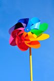 Windmill. One multi-coloured windmill toy. Blue background Stock Photo