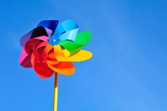 Windmill. One multi-coloured windmill toy. Blue background Royalty Free Stock Photography