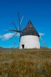 Windmill. Traditional landmark windmill amidst the fields Royalty Free Stock Photo