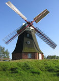 Windmill. A windmill on a green hill Stock Photos