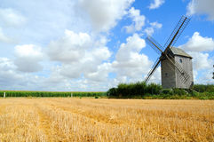 Windmill. Wind mill with blue sky royalty free stock image