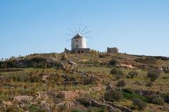 Windmill. Ancient windmill in Paros island Stock Photo