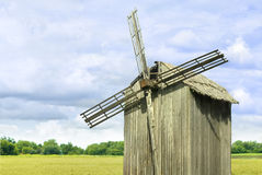 Windmill. Old Ukrainian windmill on yellow meadow Royalty Free Stock Photography