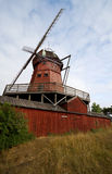 Windmill. Old traditional wooden windmill in rural area royalty free stock photos
