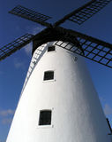 A Windmill. A White Windmill with Black Blades royalty free stock photo