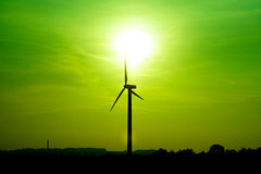 Windmill. Silhouette of a windmill in a green inviroment Stock Images