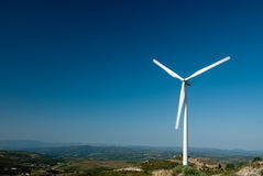 Windmill. To generate electricity on blue sky Stock Images