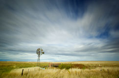 Windmill. Long exposure image of streaky clouds and windmill Stock Photography