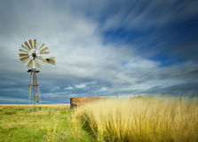 Windmill. Long exposure image of streaky clouds and windmill Royalty Free Stock Photo