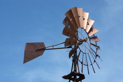 Windmill. Metallic windmill against blue sky Royalty Free Stock Images