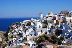 Windmill. The architecture of the village Oia on Santorini island, Greece royalty free stock photos