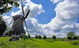Windmill. A dutch windmill inside a rural environment Stock Images