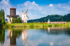 Windmill. Reflection on the water with blue sky background Royalty Free Stock Images