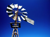 Windmill on blue sky Royalty Free Stock Photo