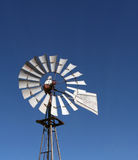 Windmill. Old metel windmill against blue sky royalty free stock images