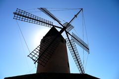 Windmill. A windmill with the sun behind it Stock Photos