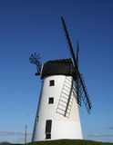 Windmill. Windmill in N W England with strong shadows of sails stock photo