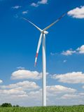 Windmill. With a green field and blue sky background stock photo