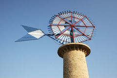 Windmill. Antique windmill on the island of Mallorca in Spain Royalty Free Stock Photography