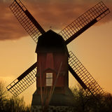 Windmill. And a sunset behind Royalty Free Stock Photo