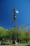 Windmill. Old windmill in a green context Royalty Free Stock Photography