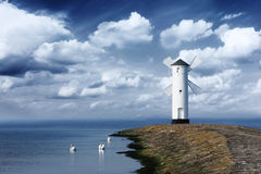 Windmill. On the seaside with cloudy sky Stock Image