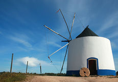 Windmill. White and blue old windmill Stock Image