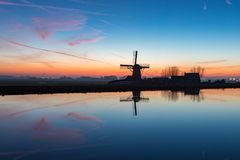Windmill the Adermolen on the ringvaart in Abbenes. royalty free stock photos