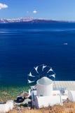 Windmill and Aegean sea from Therasia island, Santorini, Greece Royalty Free Stock Image
