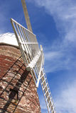Windmill against blue sky. Halnaker Windmill in West Sussex, England, against blue sky Royalty Free Stock Images