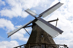 Windmill against a blue sky in sunlight Stock Photography