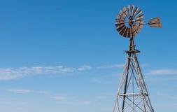 Windmill against a blue sky in Western Australia. An old water bore windmill against a blue sky near Shark Bay in Western Australia Royalty Free Stock Photos