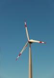 Windmill against bright blue sky. Closeup of windmill against bright blue sky Stock Photo