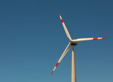 Windmill against bright blue sky. Closeup of windmill against bright blue sky Royalty Free Stock Image