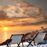 Windmill against colorful sunset, Santorini, Greece Stock Photo