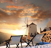 Windmill against colorful sunset, Santorini, Greece. Windmill against colorful sunset in Santorini, Greece Stock Images
