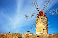 Windmill in Algadia Mallorca Spain. An old windmill in Algadia Mallorca Spain royalty free stock images