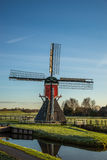 Windmill along side a canal Stock Images