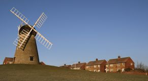 Windmill Amongst Houses Royalty Free Stock Photography